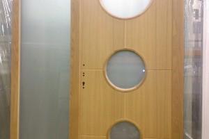 Timber Flush Entrance door with circle glass design